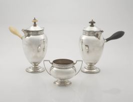 A pair of George V silver chocolate pots, Cooper Brothers & Sons Ltd, Sheffield, 1912