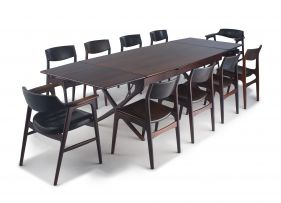 A Danish rosewood crossbanded draw-leaf dining table designed by Hans Wegner
