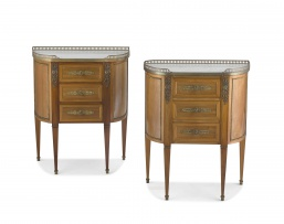 A pair of Louis XV style mahogany, fruitwood-veneered, brass-mounted and marble-topped commodes, late 19th/early 20th century