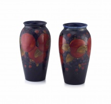 A matched pair of William Moorcroft 'Pomegranate' pattern vases, 1918
