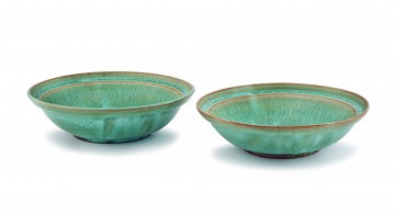 A pair of Linn Ware speckled sea green-glazed bowls
